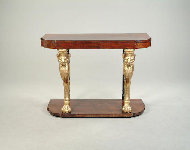 A Regency style mahogany and parcel gilt console table