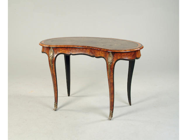 A Victorian thuya and ebonised kidney shaped writing table