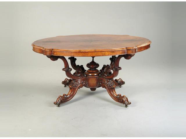A Victorian walnut breakfast table