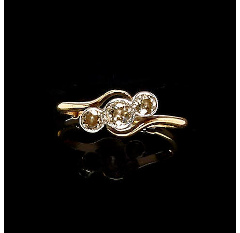 A diamond three stone crossover ring