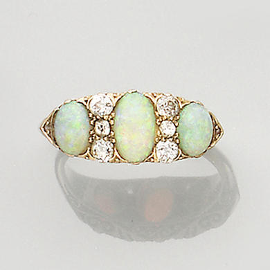A late Victorian opal and diamond three-stone ring,