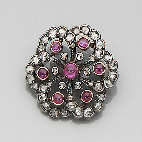A late 19th century ruby and diamond circlet brooch