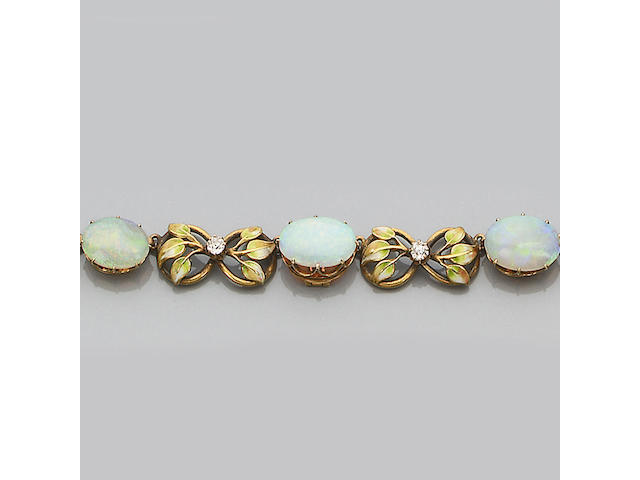An early 20th century opal, diamond and enamel bangle and necklace suite (2)