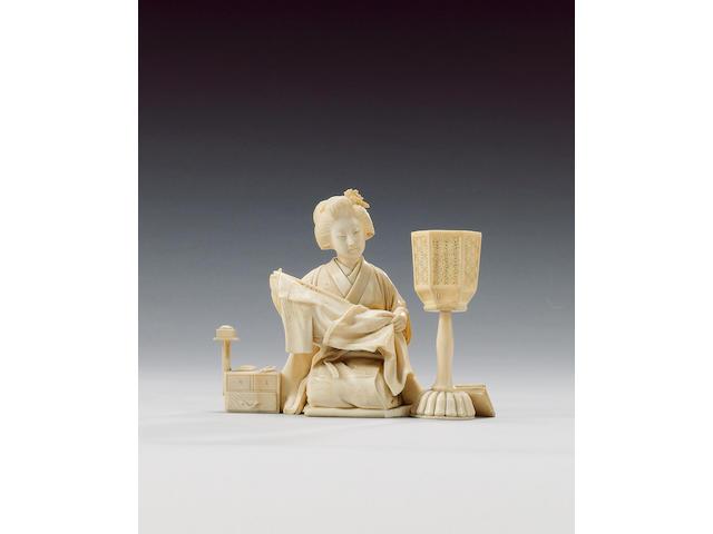 An elegant ivory okimono of a kneeling Yamato Nadeshko,