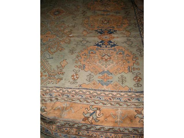 A large Ushak carpet West Anatolia, 546cm x 395cm