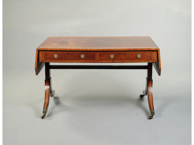 A Regency mahogany, satinwood and amboyna crossbanded sofa table