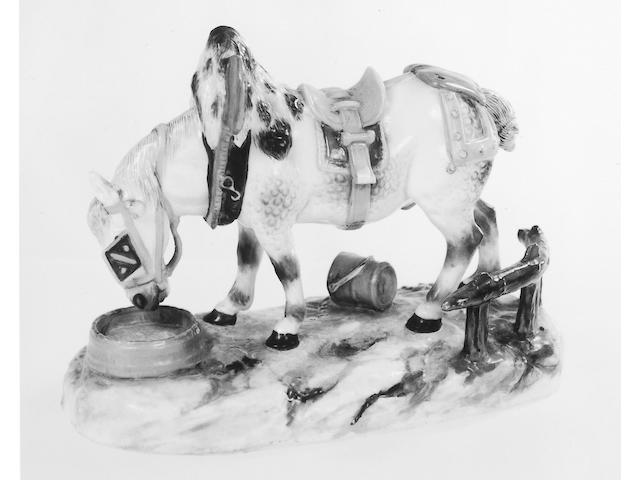A Meissen porcelain figure of a saddled and harnessed workhorse,