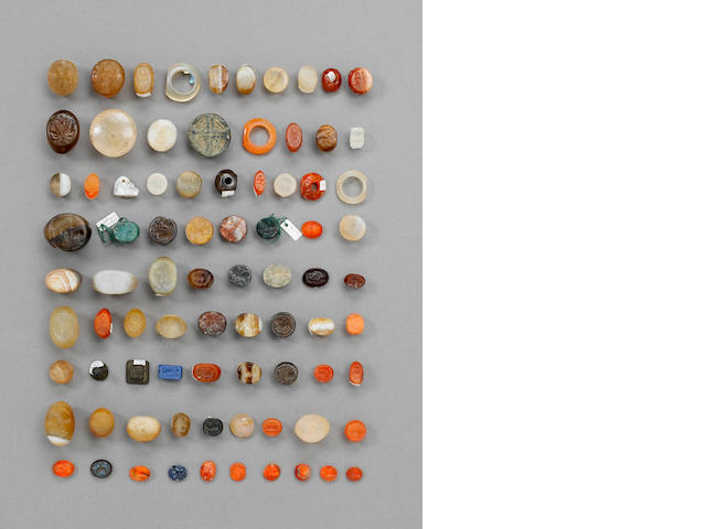 Approximately 266 ancient seals & rings in two grey plastic cabinets, with two books and a file cont