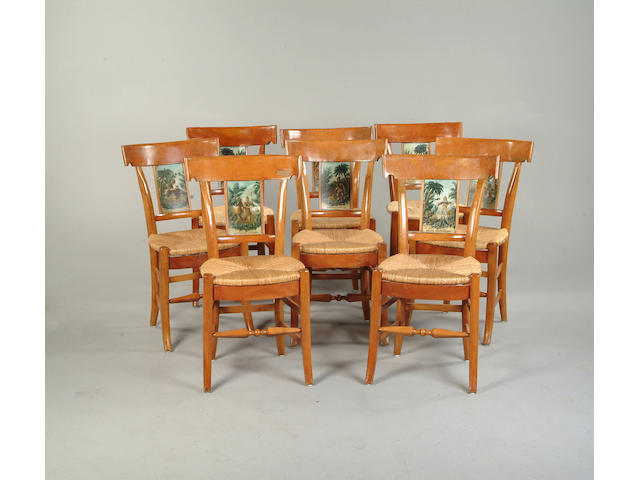 A set of eight late 19th century Swiss satin birch dining chairs