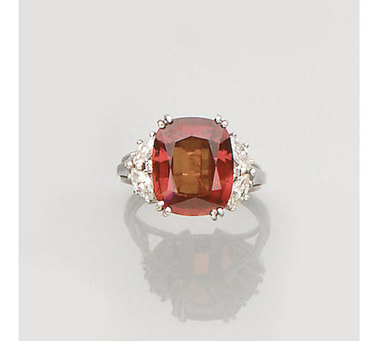 An orange sapphire and diamond ring,