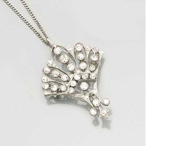 An early 20th century diamond-set pendant/brooch,