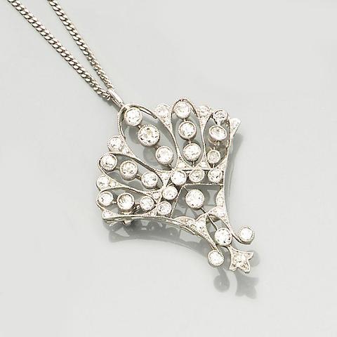 An early 20th century diamond-set pendant/brooch,