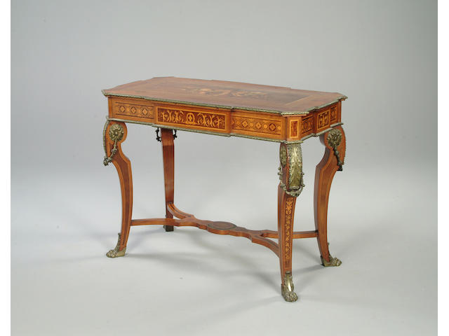 A Transitional style mahogany and marquetry centre table