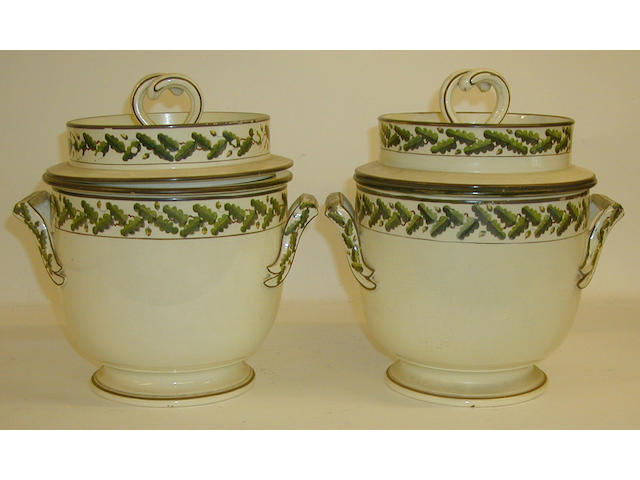 A pair of creamware ice pails, covers and liners,