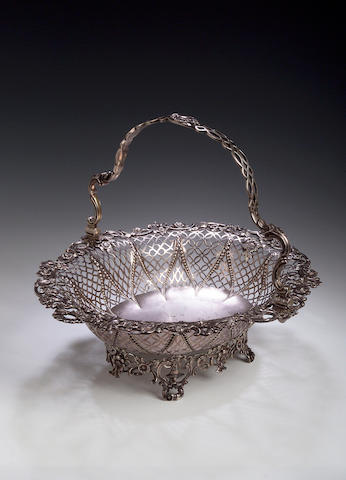 A George III silver cake basket, by William Plummer, London 1763,