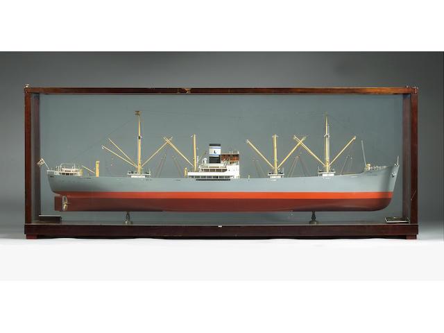 A Cased Builders Model of the Cargo Motorship TIMIOS STAVROS, ex. SKAUVANN 1939 148x56x28cm.(58x22x11in.)