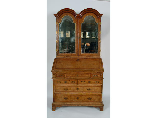 An early 18th Century walnut and burr elm double dome bureau cabinet