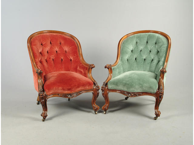 A pair of Victorian walnut armchairs