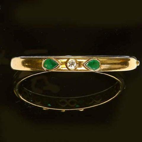 And emerald and diamond hinged bangle