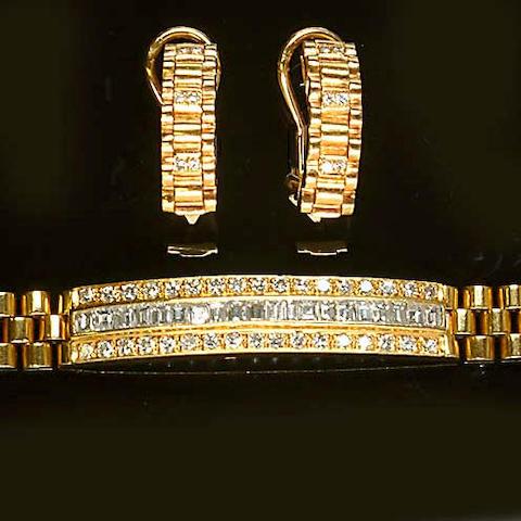 A diamond-set bracelet and earclip suite (2)