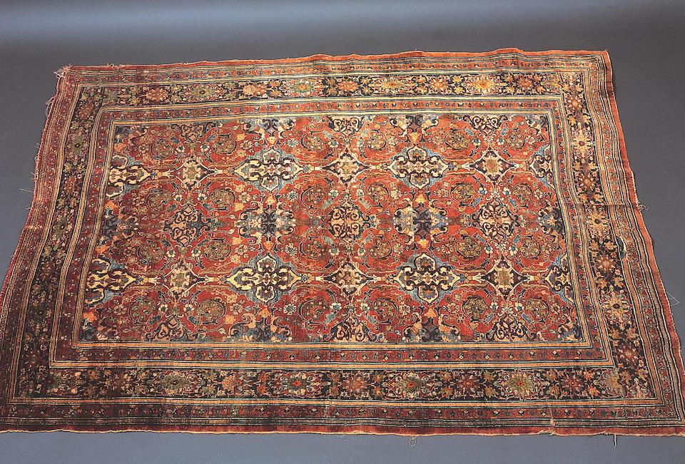 A Tabriz silk rug,