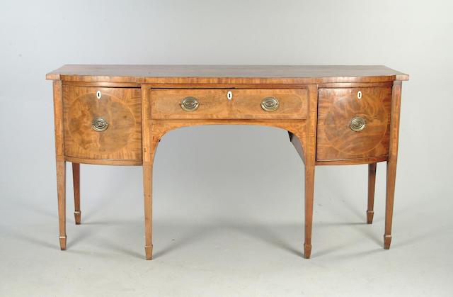 A George III mahogany and crossbanded sideboard