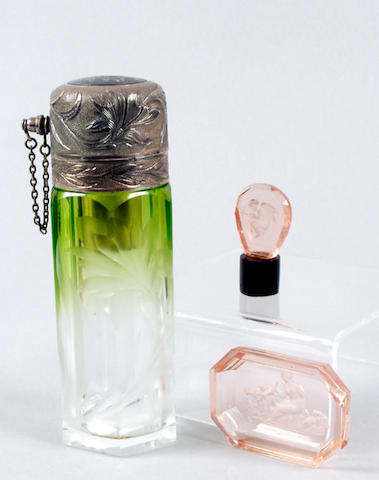 A glass and white metal atomiser unmarked,