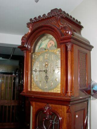 An Edwardian mahogany tubular chiming longcase clock,