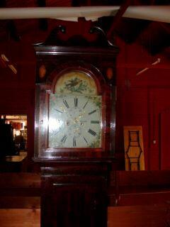 A mahogany and crossbanded painted dial longcase clock, D.Munro, Dollar, circa 1840; case earlier,