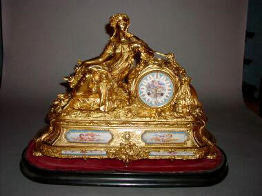 A large French porcelain mounted spelter mantel clock, retailed by Wm.Litherland, circa 1865,