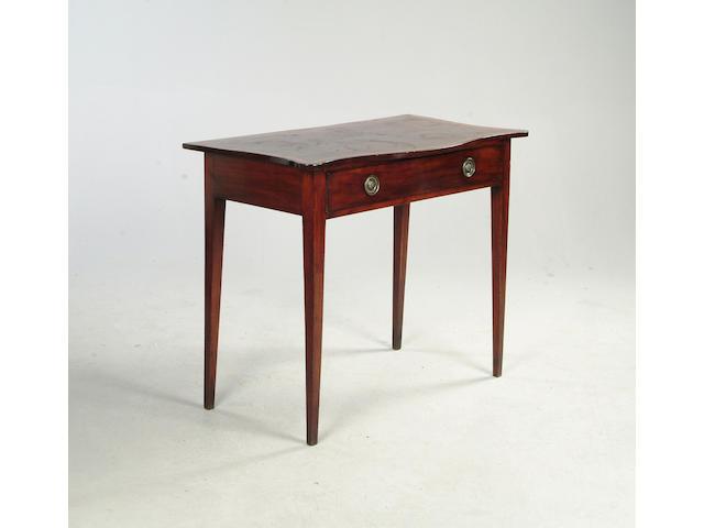 A late George III mahogany serpentine side table