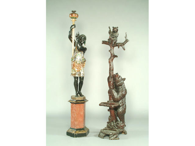 A late 19th Century Black Forest bear hat stand,