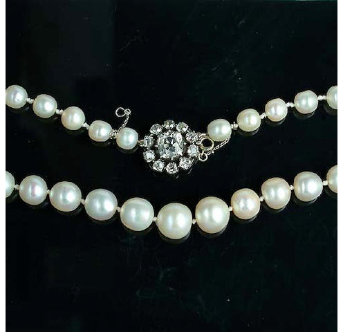 A pearl necklace with diamond clasp
