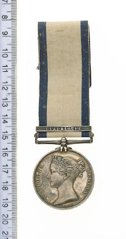 Naval General Service 1793-1840, one bar, Guadaloupe (John W.Latham, Surgn). With an Ulster Unionist Convention 1892 silver medal in case and a minor Coronation 1911 medal.