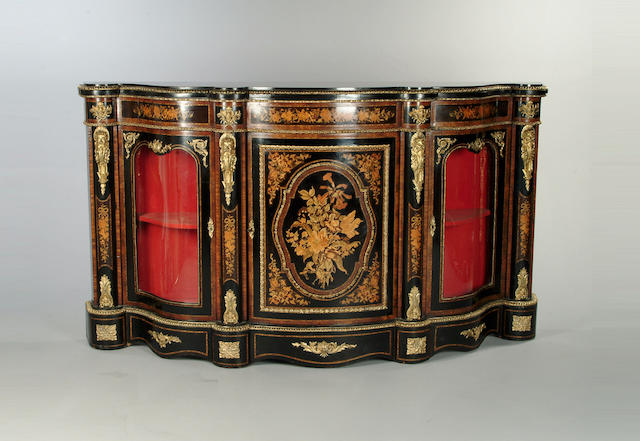 A Victorian ebonised, walnut, marquetry and gilt metal mounted serpentine credenza