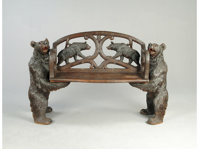 A 19th Century black forest two seat bench