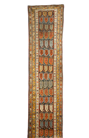 A North West Persian runner 16 ft x 3 ft 3 in (486 x 100 cm)