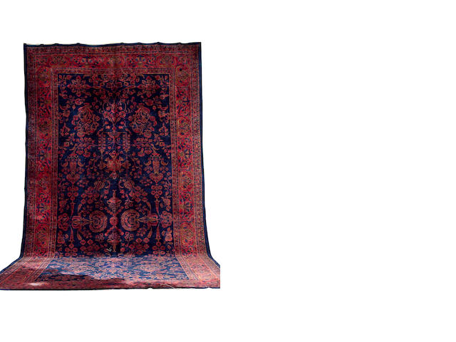 A large Sarouk carpet West Persia, 647cm x 336cm