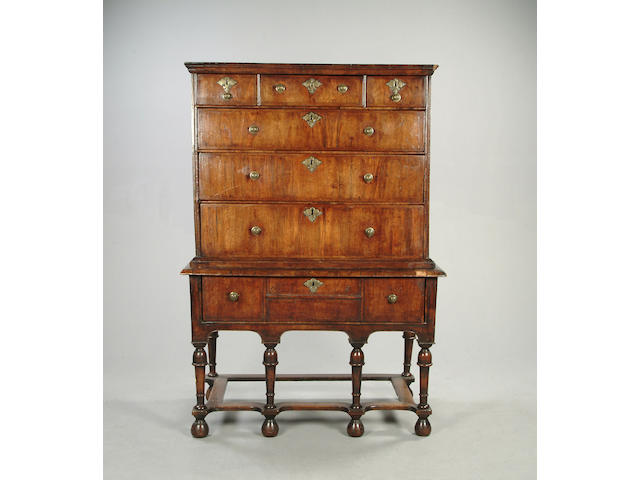 A George I walnut and oak chest on stand