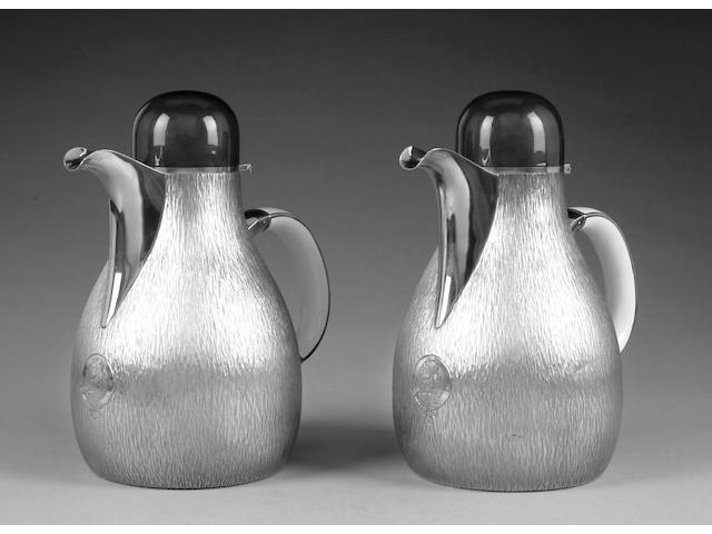 GERALD BENNEY : A pair of silver gilt and Beenham enamelled water jugs, London 1973, the bases with master enamellers mark AAE in an oval punch, for Alan Alfred Evans, stamped GERALD BENNEY LONDON,