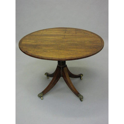 A Regency style rosewood and boxwood strung circular breakfast table,