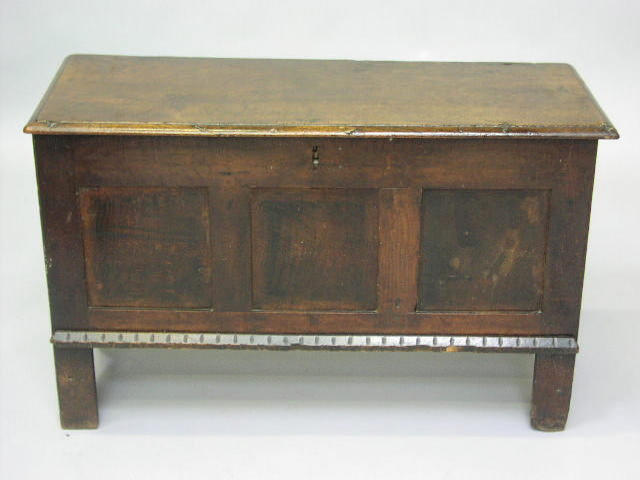 A 17th Century oak coffer with hinged rectangular top,