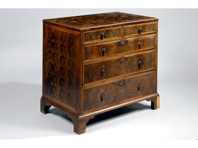 A late 17th Century walnut oyster and acacia banded chest of drawers
