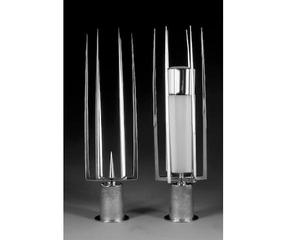 GERALD BENNEY : A pair of silver pricket candlesticks, London 1966,