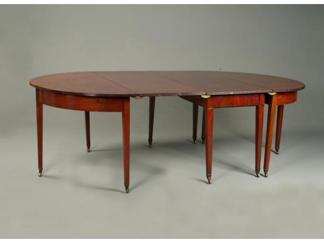 An early 19th century mahogany dining table