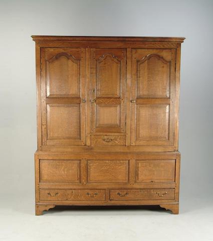 An oak livery cupboard