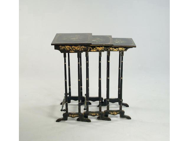 A nest of three late Regency papier maché tables