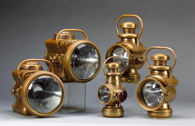 Five brass lamps (5)
