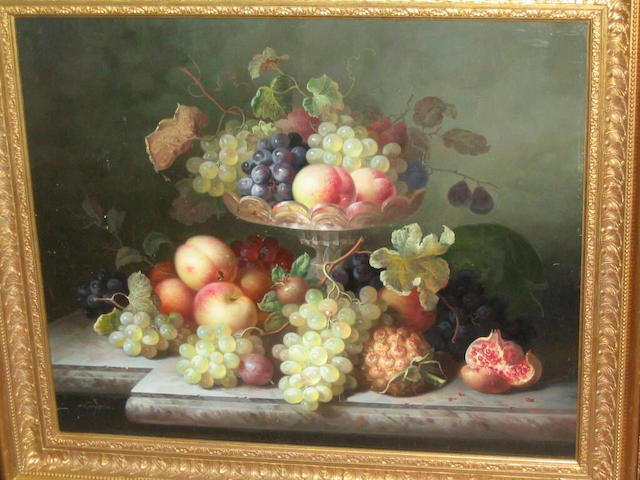 R. Caspers (20th Century) Still life of grapes, peach, plum, pineapple, pomegranate and glass tazza on a marble ledge, 49 x 59.5cm.