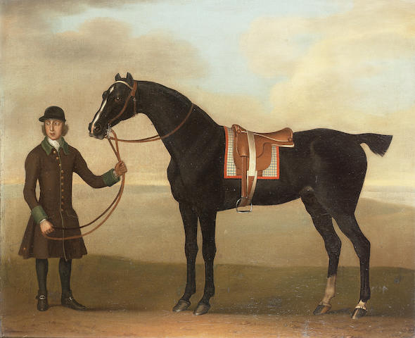 James Seymour (London 1702-1752) A black hunter held by a groom in a landscape 50.7 x 62.1 cm. (20 x 24½ in.)